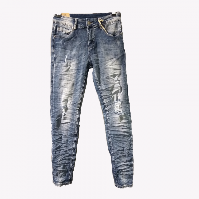 Jean trousers with rips and discoloration